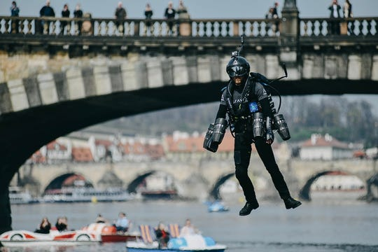 Richard Browning hovers over the Vltava River in Prague, Czech Republic.