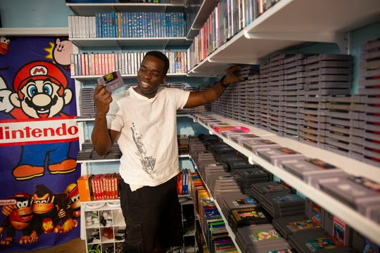 Carl Multidor of Naples, shares fond memories of playing Super Nintendo's Super Tennis during a visit to the 8-Bit Hall of Fame in Bonita Springs on Wednesday, Feb. 19, 2020.