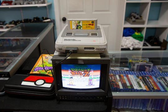 A Nintendo Super Famicom with a Dragon Ball Z game is displayed, Wednesday, Feb. 19, 2020, at the 8-Bit Hall of Fame in Bonita Springs. The Nintendo Super Famicom was originally released in 1990 followed by the North American version, Super Nintendo in 1991.