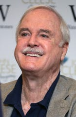 John Cleese British comedian John Cleese signs copies of his book 'So, Anyway', ahead of the book signing at Waterstones Piccadilly, in central London, Thursday, Oct. 9, 2014. (Photo by Joel Ryan/Invision/AP)