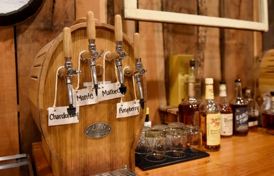 Sand Hollow Speakeasy offers whiskey, wine, and beer behind their bar in Newark.