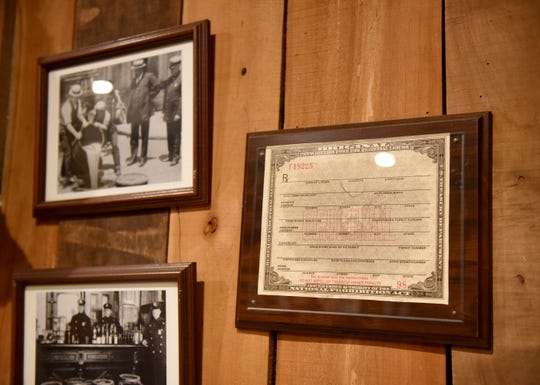 A copy of a prescription for alcohol hangs in Sand Hollow Speakeasy in Newark.