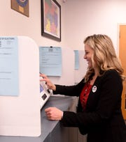 Licking County Treasurer Olivia Parkinson takes a break from collecting property taxes to vote early in the primary election on Wednesday, Feb. 19, 2020 at the Licking County Board of Elections office, on the first floor of the Don Hill Licking County Administration Building, 20 South Second St., in downtown Newark.