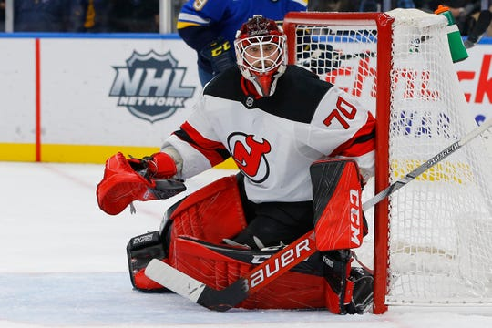New Jersey Devils goaltender Louis Domingue defends the net during the second period of an NHL hockey game against the St. Louis Blues Tuesday, Feb. 18, 2020, in St. Louis.