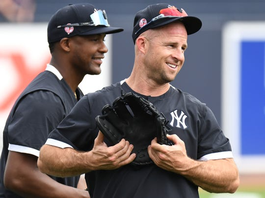 Feb 19, 2020; Tampa, Florida, USA; New York Yankees  outfielder Brett Gardner (right) warms up during spring training at George M. Steinbrenner Field.