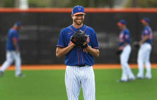 Feb 16, 2020; Port St. Lucie, Florida, USA; New York Mets pitcher Jacob deGrom warms-up before a workout during spring training.
