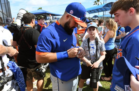 Feb 18, 2020; Port St. Lucie, Florida, USA; New York Mets infielder Luis Guillorme signs autographs at spring training.