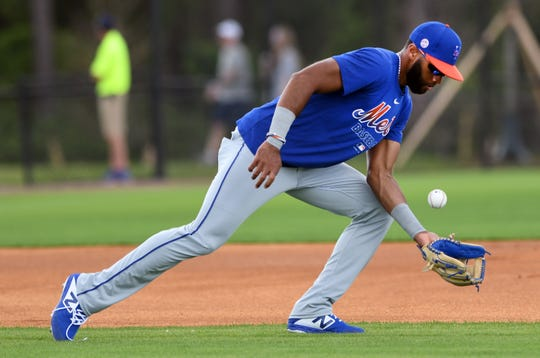 Feb 18, 2020; Port St. Lucie, Florida, USA; New York Mets infielder Amed Rosario fields a ground ball during spring training.