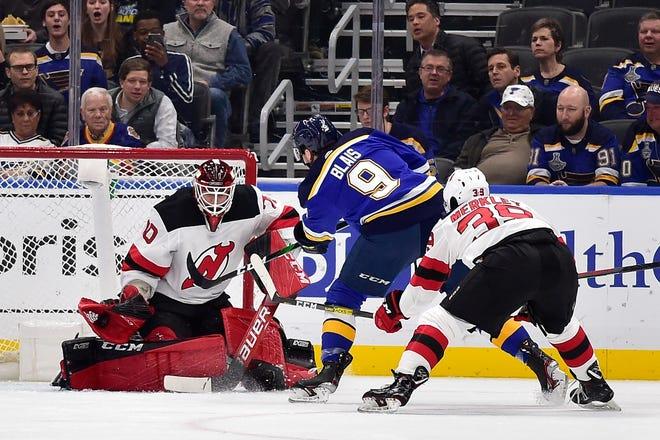 Feb 18, 2020; St. Louis, Missouri, USA;  New Jersey Devils goaltender Louis Domingue (70) makes a save against St. Louis Blues left wing Sammy Blais (9) during the first period at Enterprise Center.