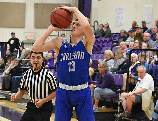 Carlsbad senior Riley Hestand pulls up for a third-quarter corner 3 in Tuesday's District 4-5A game at Clovis.