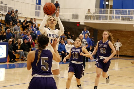 Carlsbad's Teran Tiller takes a contested shot against Clovis in the first half of their district game against Clovis on Feb. 18, 2020. Carlsbad won, 43-30.