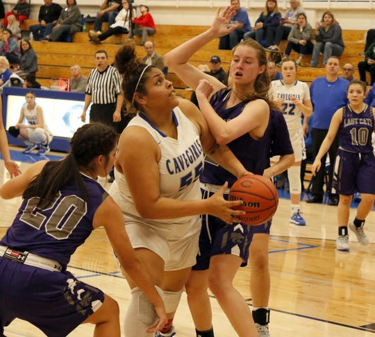 Carlsbad's Kaliyah Montoya battles through Clovis defenders in the second half of their District 4-5A game against Clovis on Feb. 18, 2020. Montoya finished with 14 points and Carlsbad won, 43-30.