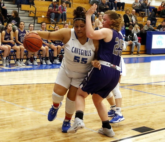 Carlsbad's Kaliyah Montoya drives by Clovis' Hannah Nussbaumer in the first half of their District 4-5A game on Feb. 18, 2020. Montoya finished with 14 points and Carlsbad won, 43-30.