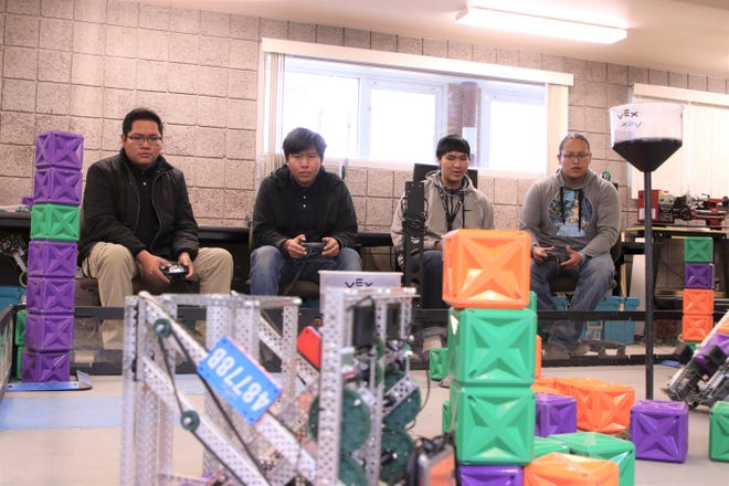 From left to right; Michael Nez, Dominic Cambridge, Ian Whitehorse and Adriano Begay of Navajo Preparatory School's Robotics practice with their robots at Navajo Preparatory School in Farmington on Feb. 19, 2020.