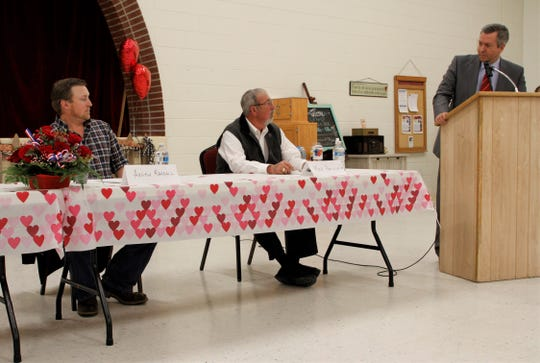 At right, forum moderator Scott Michlin asks former mayor Michael Padilla Sr. a question while incumbent Commissioner Austin Randall listens, Tuesday, Feb. 18, 2020, during a candidate forum at Aztec Senior-Community Center.