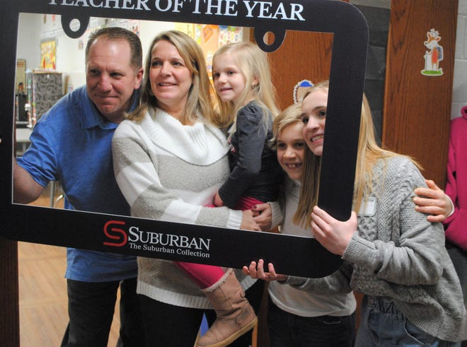 Jackie Pinter and her family after Pinter was named teacher of the year.