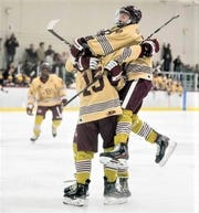 Conor Place (15) celebrates with teammates after scoring his first goal of the season in December.