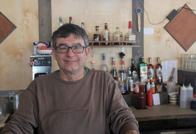 Canton Township resident Dan Calcaterra stands behind the bar at Tucker's Kitchen and Bar in New Hudson Feb. 19. The restaurant closed Feb. 19 after three years in business and will soon be occupied by Jonna's Bar and Grill.