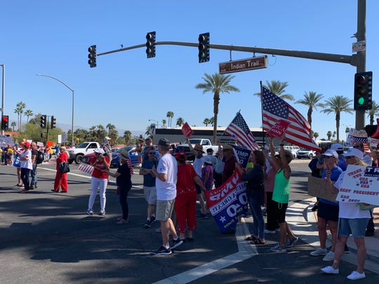 Trump supporters and protesters stepped into the roadway at Highway 111 and Indian Trail in Rancho Mirage Wednesday as they awaited the president's motorcade. The group of more than 200 people blocked Highway 111 traffic as they chanted, waved signs and watched for the president's caravan of vehicles heading from the airport to Oracle Chairman Larry Ellison's Porcupine Creek, in the Magnesia Falls neighborhood of Rancho Mirage.