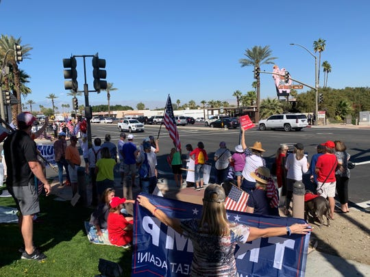 A group of more than 50 Trump supporters await President Trump's motorcade Wednesday after word spread that Air Force One had touched down at Palm Springs International Airport. Trump arrived in the Coachella Valley to attend a private fundraising event hosted by Oracle Chairman Larry Ellison at his Rancho Mirage estate, Porcupine Creek.
