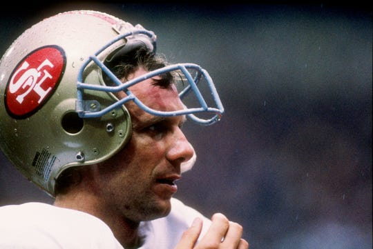 31 Jul 1988: Joe Montana stands on the sidelines during the American Bowl against the Miami Dolphins at Wembley Stadium in London, England. The Dolphins won the game 27-21.