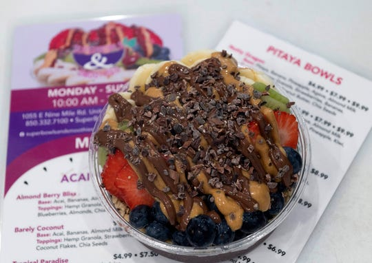 The Ultimate Power Bowl is a customer favorite at the new SuperBowls & Smoothies on East Nine Mile Road. A variety of mixed fruits fill the acai-based creation topped with chia seeds, cacao nibs, peanut butter and Nutella.