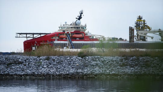 A giant red ship called the Deep Explorer is docked at the Port of Pensacola on Wednesday. The offshore support vessel is being worked on by Offshore Inland Marine & Oilfield ServicesInc.