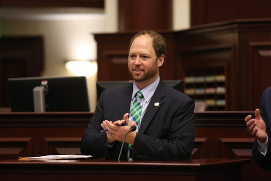 Rep. Jayer Williamson, R-Pace, reads a resolution Feb. 19 on the House floor commending the University of West Florida national championship football team.