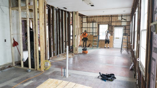 Workers from Bontrager Builders Group, Inc. work on the renovation of a cottage home built in 1890 at 423 E. Government St. on Wednesday, Feb. 19, 2020.