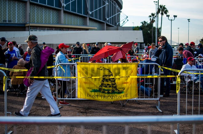 A Gadsden flag hangs in line on Feb. 19, 2020, the morning of a rally held by President Trump at the Veterans Memorial Coliseum on the Arizona State Fairgrounds in Phoenix.
