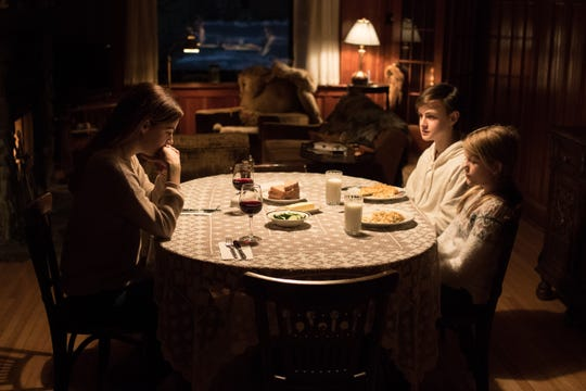 """Riley Keough (from left), Jaeden Martell and Lia McHugh in a scene from """"The Lodge."""""""