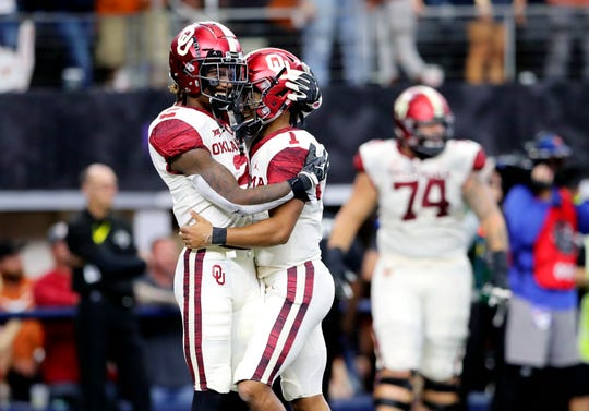 Oklahoma Sooners quarterback Kyler Murray (1) and wide receiver CeeDee Lamb (2) celebrate a touchdown during the fourth quarter against the Texas Longhorns in the Big 12 Championship game at AT&T Stadium on Dec. 1, 2018.