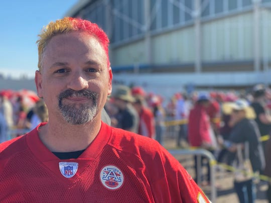 Chris Phillips came from Kansas City, Missouri, to see President Donald Trump at a rally on Feb. 19, 2020, at Veterans Memorial Coliseum in Phoenix. This is his fourth Trump rally. He's one of many who travel to see Trump.