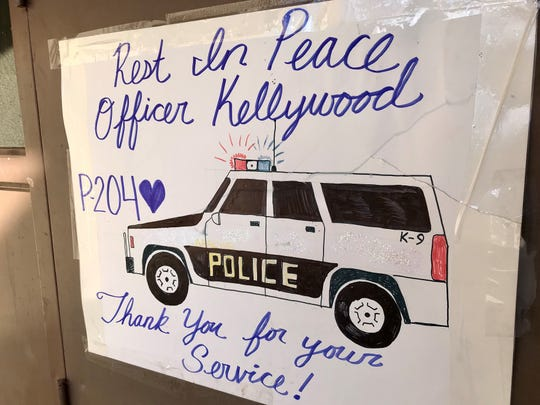 A memorial was set up in honor of White Mountain Apache Police Officer David Kellywood outside the White Mountain Apache Police Department on Feb. 18, 2020.