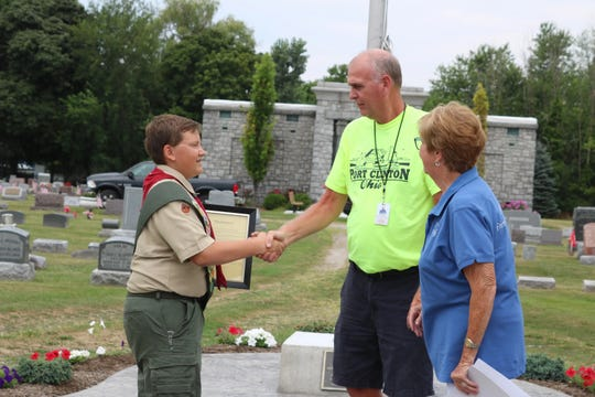Tracy Colston, center, has been promoted to serve as Port Clinton's safety-service director long-term. Here, Colston jones Sandra Koch, of the Friends of the Cemetery, to congratulate Jayce Kennedy as he reached the rank of Eagle Scout with a project to revitalize Lakeview Cemetery's veterans' memorial in 2018.