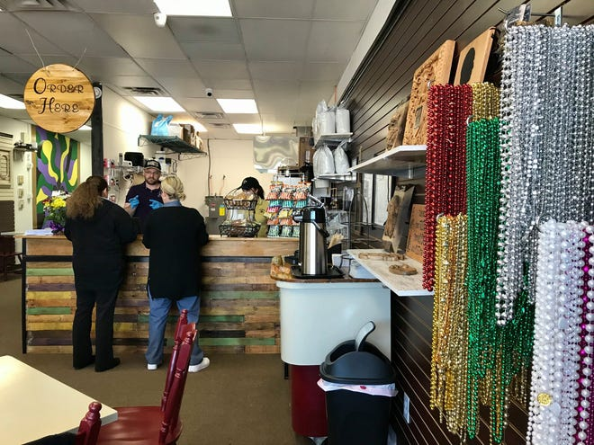 Cafe Nola co-owner Chris Shifflett takes orders on Cafe Nola's opening day in Kimball Township on Feb. 19, 2020.