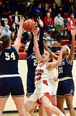 Port Huron's Morgan James fights for a loose ball against Macomb Dakota in a Macomb Area Conference Red/White girls basketball game on Tuesday, Feb. 18, 2020.