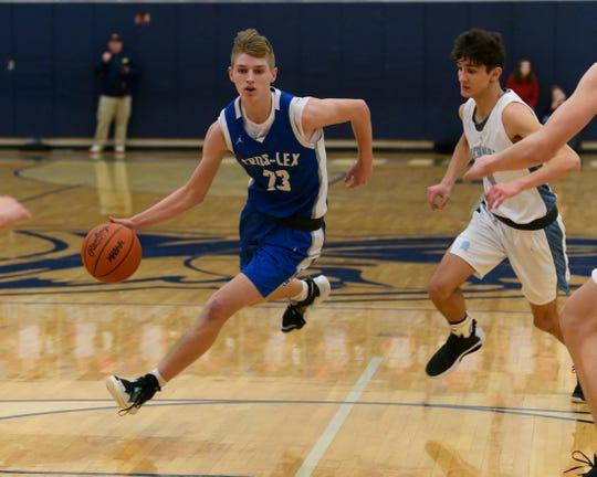 CrosLex's Tyler Johnson dribbles to the basket Tuesday, Feb. 18 during their basketball at Richmond High School.