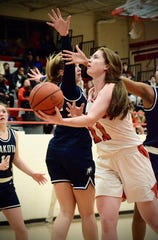 Port Huron's Emma Trombly shoots against Macomb Dakota during a Macomb Area Conference Red/White girls basketball tournament game on Tuesday, Feb. 18, 2020.