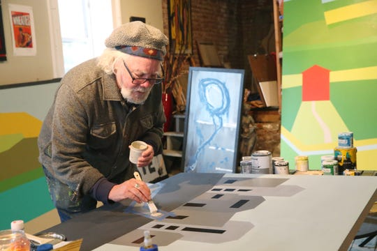 Rick Rogers works on a painting while inside his art studio in Beacon on February 18, 2020.
