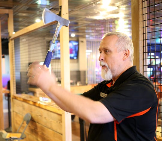 Ax Master Marshall Smith demonstrates axe throwing at Spins Bowl Poughkeepsie on February 18, 2020.