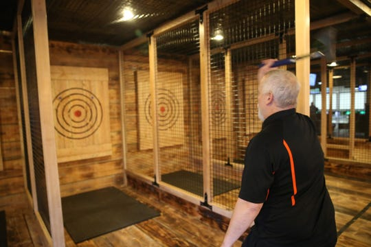 Ax Master Marshall Smith demonstrates ax throwing at Spins Bowl Poughkeepsie on February 18, 2020.