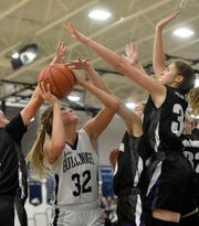 Alyssa Zorbauugh of West York looks to shoot through a host of Northern York defenders during the District 3 Class 5-A basketball, Monday, February 18, 2020.John A. Pavoncello photo