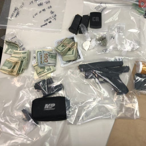 Officers recovered heroin and crack cocaine packaged for sale throughout the apartment, digital scales, packaging material, over $4,000, multiple pistol magazines containing live ammunition and a stolen firearm, according to a news release.