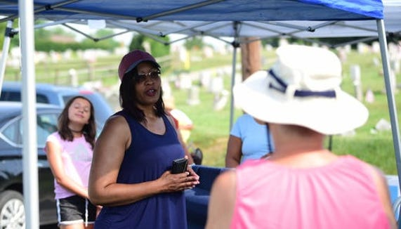 Samantha Dorm explains to volunteers the importance of cleaning up Lebanon Cemetery in July. She has asked the York community to check their art collections in case there's a painting by noted black artist Virginia Haar hanging on a wall or in storage.