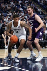 Feb 15, 2020; University Park, Pennsylvania, USA; Penn State Nittany Lions guard Myles Dread (2) dribbles the ball after getting the rebound as Northwestern Wildcats guard Pat Spencer (12) defends during the second half at Bryce Jordan Center. Penn State defeated Northwestern 77-61. Mandatory Credit: Matthew OHaren-USA TODAY Sports
