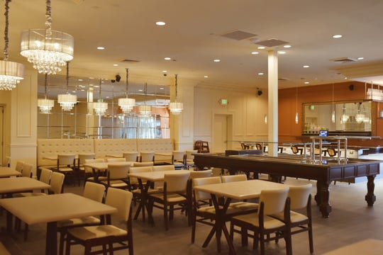 The new all-you-can-eat Churrasco Brazilian Steakhouse replaces its dark predecessor with cream paneling and crown moldings, light mocha padded banquettes, and a bar accomplished in burnt orange.