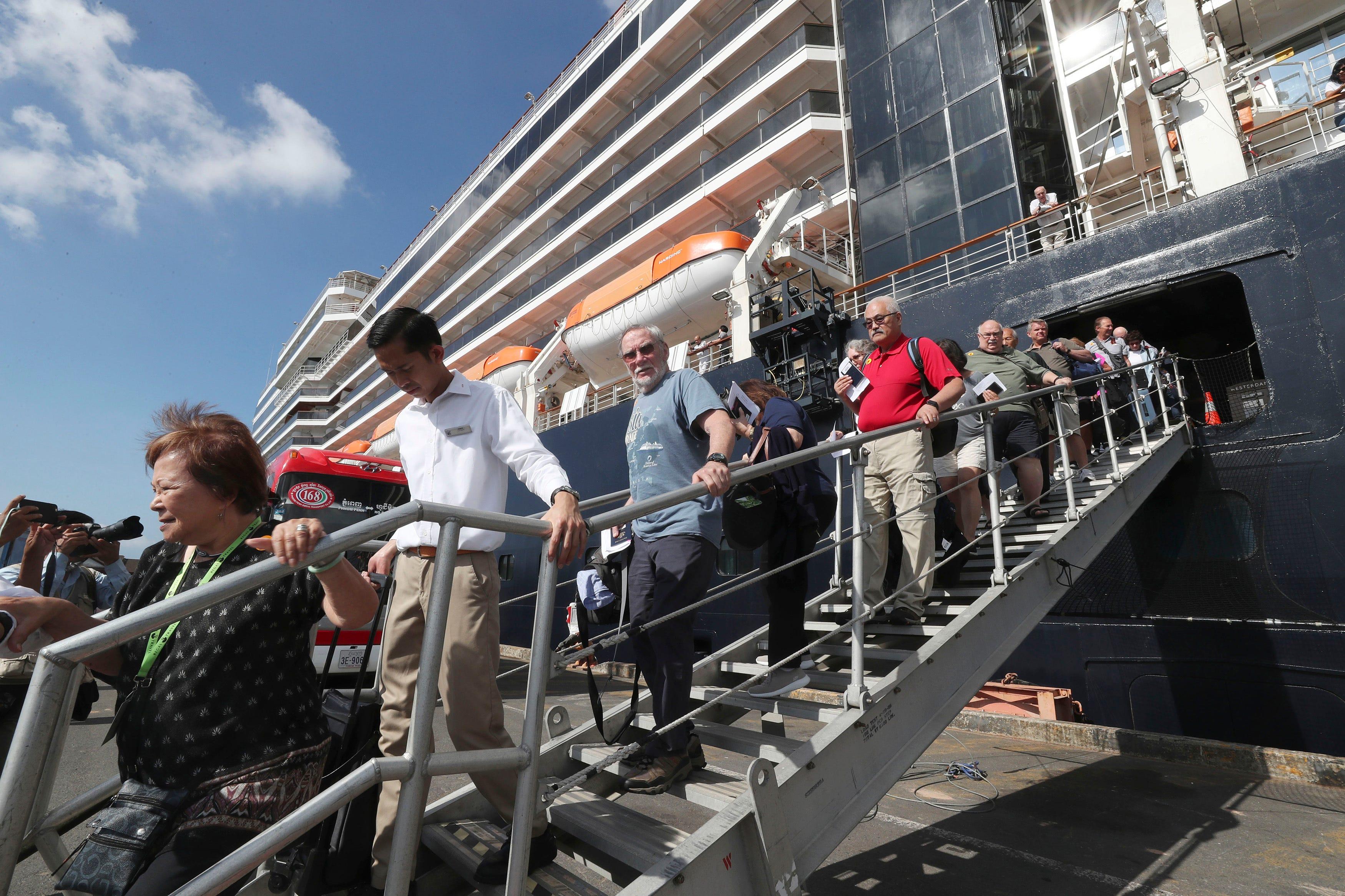 MS Westerdam passengers test negative for coronavirus; hundreds allowed to depart Cambodia