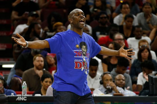 FILE - In this July 16, 2017, file photo, 3 Headed Monsters coach Gary Payton questions a call during a Big3 basketball game against Killer 3's in Philadelphia, Pa. Ice Cube is serious about growing the Big3, heavy on nostalgia, into more than just another niche sports league. Big3 basketball has made it to a third season, barnstorming this summer from Birmingham to Brooklyn, shooting 4-pointers in pickup-style games where first to 50 points wins.