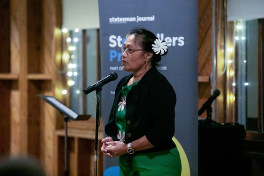 "Tasi Keener speaks about finding community during the Salem Storytellers Project's ""For Your Entertainment"" night Feb. 19 at the Dye House at the Willamette Heritage Center in Salem."
